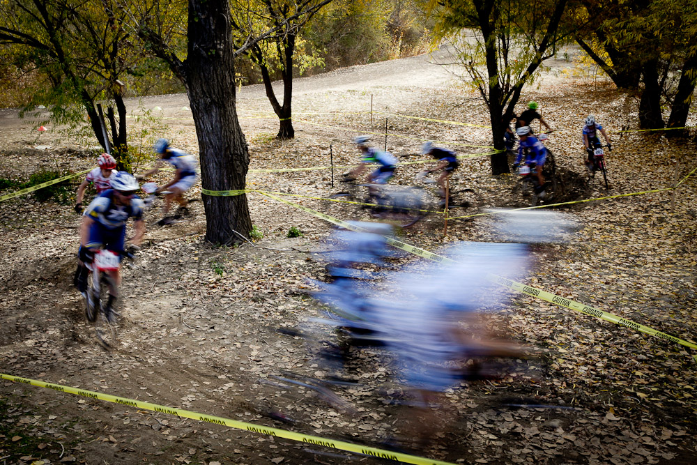 Bikers Blur by the Camera at a UTCX Cyclocross Bike Race at Soldier Hollow in Salt Lake City, Utah.
