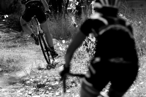 Dust kicks up from the tires of a bike racer at the UTCX Cyclocross Race