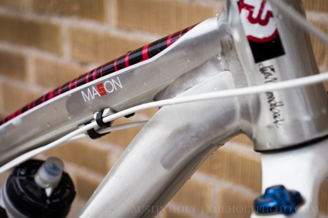 The Mason toptube logo and raw aluminum frame finish