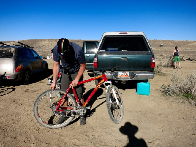 Brian checking his hardtail at camp on 18 road in Fruita