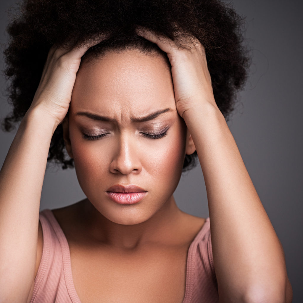 Woman with a Headache treating chronic pain at the dentist arlington heights il
