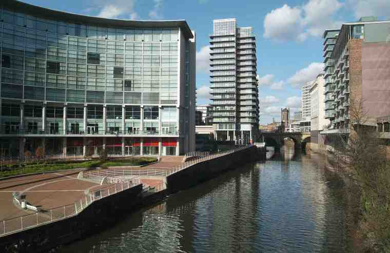 The Lowry Hotel Edge Apartments and River Irwell. Blackfriars Bridge and Manchester Cathedral can be seen straight ahead.