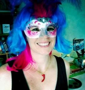 The author models a fanciful mask on her blog. Photo courtesy of lainitaylor.com
