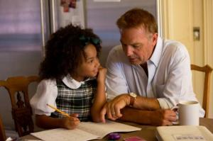 Eloise works on homework with her grandfather in 'Black or White.' Photo courtesy of imdb.com