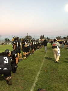 The Hornets took to the field for the National Anthem. Photo by Alex Tong