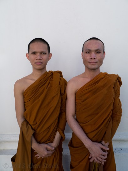 I noticed these monks speaking English to a tourist and I asked if I could get their photos. They were visiting from another part of Thailand.