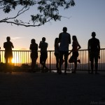 Silhouette Noosa viewpoint backpackers enjoy sunset