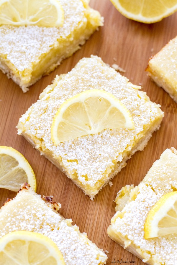These sweet bars are filled with tangy lemon filling sitting on top of ...