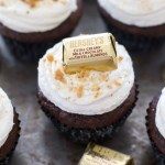 These rich chocolate cupcakes are topped with creamy vanilla buttercream, and are decorated with chocolates, toffee, and crushed graham crackers to look like hidden treasure! Perfect for a pirate themed party.   www.alattefood.com