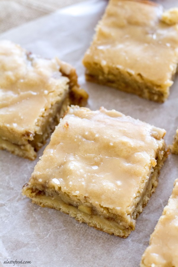 These chewy apple blondies taste like apple pie and are covered in a sweet maple glaze. You're sure to fall in love.