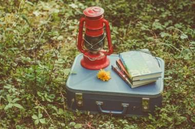 books lantern suitcase