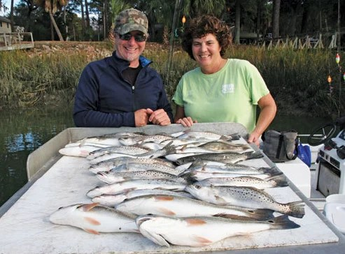 Capt. Matt Williams and Capt. Kathy Brown did good catching lots of spotted sea trout and red fish. Photography by Capt. Judy Helmey