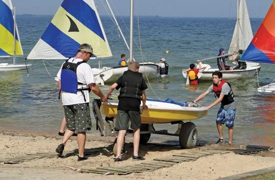 Sea Scouts launch a small boat at the Sailoree. Photo By Capt. Bob Webb