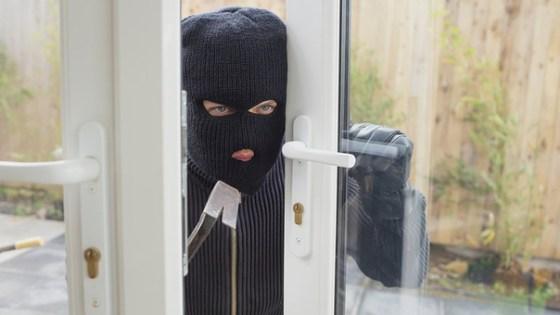 Burglar opening the door with crobar