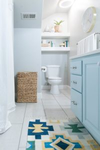 Kids Bathroom remodel with pops of light turquoise ...