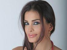 بالصور.. دومينيك حوراني بفستان مثير في مهرجان دبي السينمائي