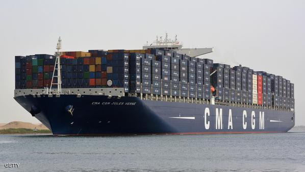 A picture taken on May 30, 2013 from the Egyptian port of Ismailia, 120 kilometers northeast of Cairo, shows the new largest container ship in the world, French flag Jules Verne, crossing the Suez Canal. AFP PHOTO/STR        (Photo credit should read STR/AFP/Getty Images)