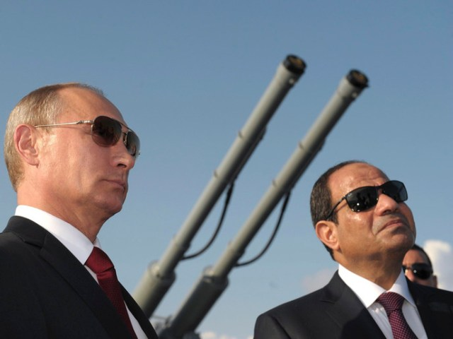 Russia's President Vladimir Putin (L) and his Egyptian counterpart Abdel Fattah al-Sisi attend a welcoming ceremony onboard guided missile cruiser Moskva at the Black Sea port of Sochi, August 12, 2014.     REUTERS/Alexei Druzhinin/RIA Novosti/Kremlin (RUSSIA - Tags: POLITICS MILITARY TPX IMAGES OF THE DAY) ATTENTION EDITORS - THIS IMAGE HAS BEEN SUPPLIED BY A THIRD PARTY. IT IS DISTRIBUTED, EXACTLY AS RECEIVED BY REUTERS, AS A SERVICE TO CLIENTS