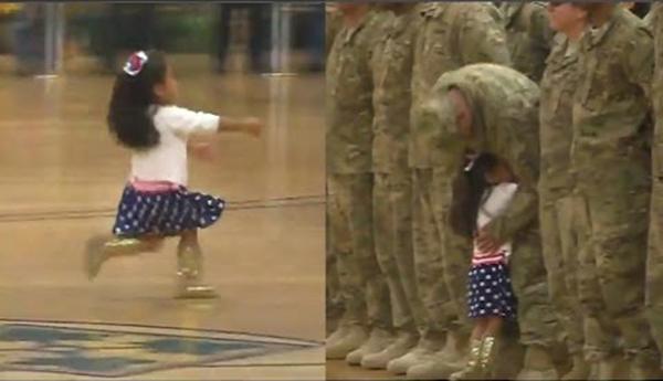طفلة تخرق عرضا عسكريا لتعانق والدها