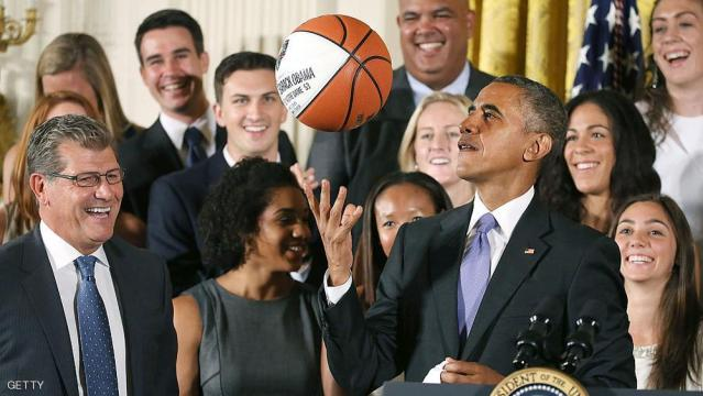 WASHINGTON, DC - SEPTEMBER 15: U.S. President Barack Obama tosses up a basketball given to him by coach Geno Auriemma (L) while honoring the 2015 NCAA Women's Basketball Champion University of Connecticut Huskies during a ceremony in the East Room at White House September 15, 2015 in Washington, DC. President Obama honored the Huskies for winning their third consecutive title with 10 overall.  (Photo by Mark Wilson/Getty Images)