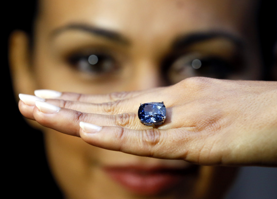 Model Charlene Bonnithon displays the rare Blue Moon Diamond at Sotheby's auction rooms in London, Thursday, Sept. 17, 2015. The 12.03 carat blue diamond is the largest cushion shaped fancy vivid blue diamond to ever appear at auction. It is expected to realise 35-55 million US Dollars (23-35 million UK pounds) when it is auctioned in Geneva on Nov. 11. (AP Photo/Kirsty Wigglesworth)