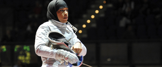 Ibtihaj Muhammad, of the United States, looks on prior to the start of a women's team sabre qualifying match at the World Fencing Championship in Catania, Italy, Saturday, Oct. 15, 2011. (AP Photo/Carmelo Imbesi)