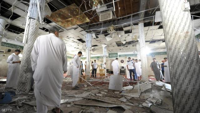Saudi men gather around debris following a blast inside a mosque, in the mainly Shiite Saudi Gulf coastal town of Qatif, 400 kms east of Riyadh, on May 22, 2015. A suicide bomber targeted a Shiite mosque during Friday prayers in Kudeih in Shiite-majority Qatif district, the interior ministry said, with activists saying at least four worshippers were killed. AFP PHOTO / HUSSEIN RADWAN        (Photo credit should read HUSSEIN RADWAN/AFP/Getty Images)