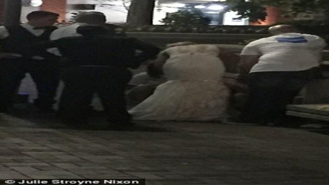 ممرضة تتعامل مع حالة طوارئ بثوب زفافها