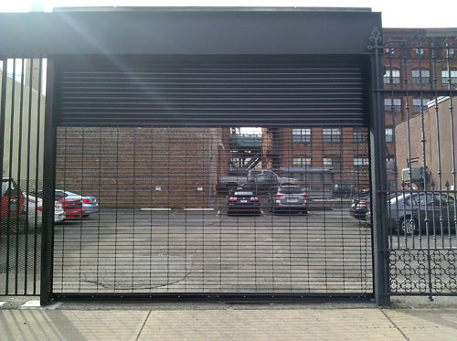 Overhead rolling security grilles and gates