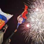 People watch fireworks at the central Nakhimov square in Sevastopol, Crimea