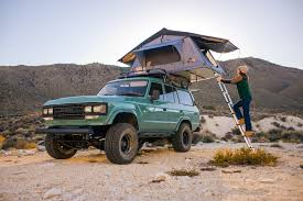 green car with tent on top