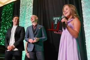 Joe King and Isaac Slade are smitten by the charms of Vienna Danna, recipient of the Volunteer of the Decade Award.  The Transplant Hero Awards, benefiting the American Transplant Foundation, at The Ritz-Carlton, Denver, in Denver, Colorado, on Saturday, June 11, 2016. Photo Steve Peterson