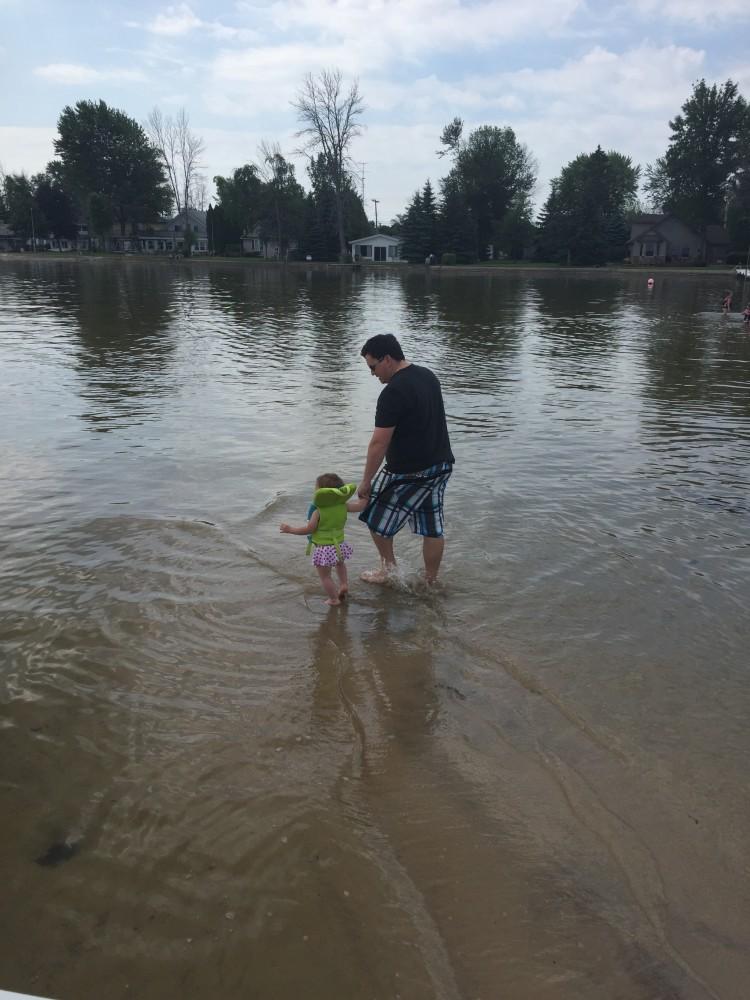 Emmy and her godfather, Brad, taking a walk.