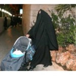 veiled woman with stroller