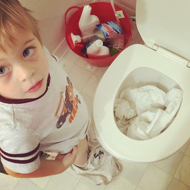toddler clogs toilet with toilet paper
