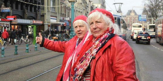 The famous twin prostitutes of The Netherlands, waiting for the next tram in Amsterdam.