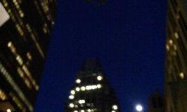 moonrise in Boston against skyscrapers