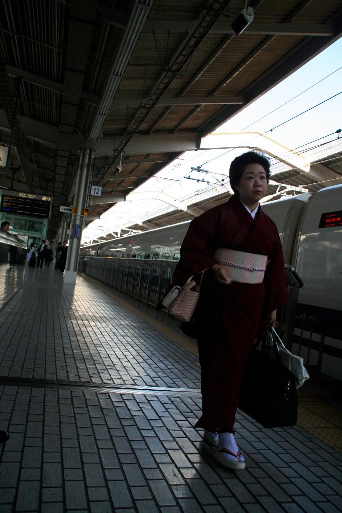 Japanese woman dressing kimono at Kyoto train station