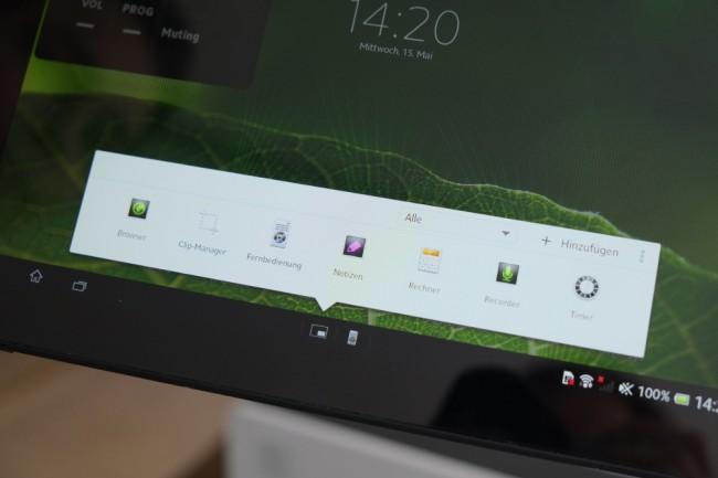 Schnellstartleiste: Hier finden Sie nützliche Tools wie einen Rechner, eine Notiz- App oder die Fernbedienung. Sie können Apps beliebig aus der Leiste entfernen oder hinzufügen