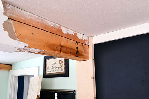 Haphazardly Sheetrock Covered Kitchen Beam