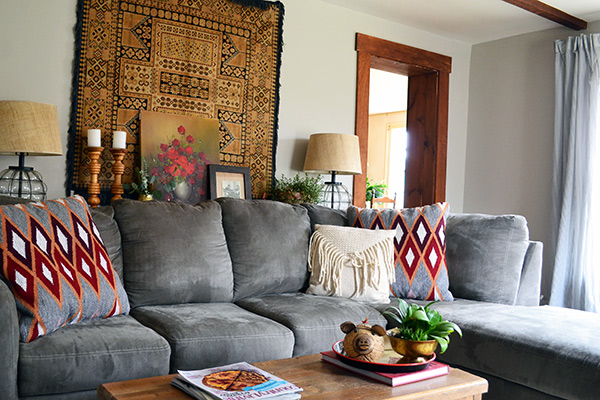 Styling Behind A Living Room Couch With A Vintage Tapestry