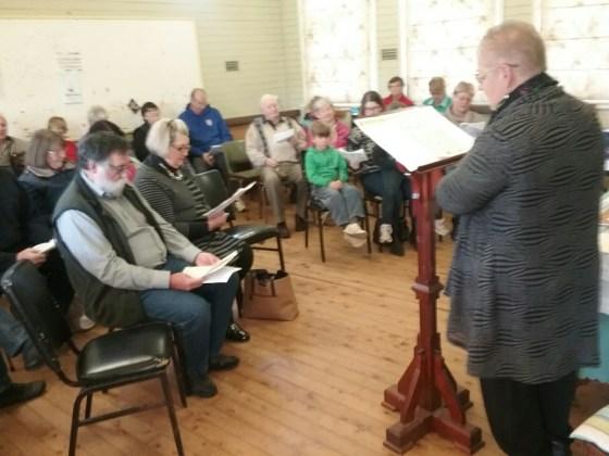 Parish Lay Minister Jenny Tunks leads whole parish worship  at the Elong.