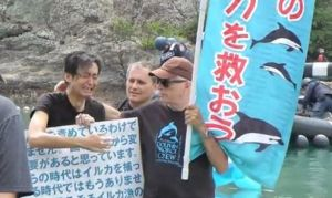 Sakae Hemmi, left, of the Japanese conservation group Elsa Nature Conservancy, with Ric O'Barry (holding banner)