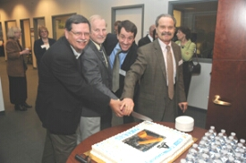 Ray Tice of the National Toxicology Program, Bob Kavlock of the EPA, and David Jacobson-Kram of the FDA, cutting birthday cake for the Tox21 robot. (National Chemical Genomics Center photo.)