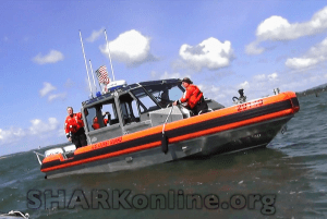 U.S. Coast Guard patrol boat maintains exclusion zone. (SHARK photo)