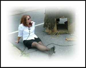 Dogs Deserve Better founder Tamira Ci Thayne found chaining herself to doghouses in public places to be a more effective mode of protest than self-destruction. (DDB photo)