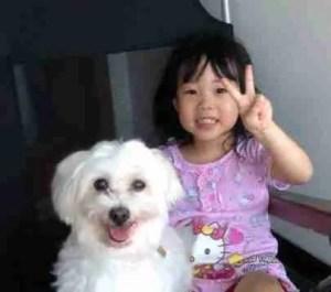 Bali girl & her dog.  (BAWA photo)