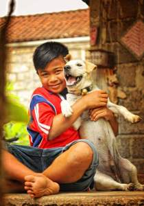 Boy with traditional Bali dog. (BAWA photo)