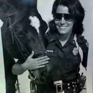 Beth Clifton as Miami Beach mounted patrol officer.