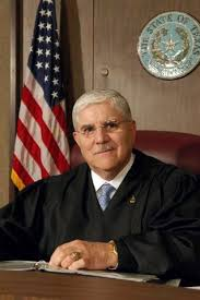 Nueces County District Judge Jose Longoria.